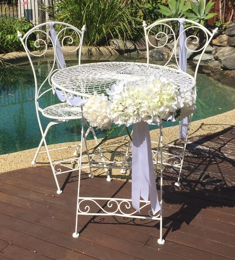 Table & Chairs with Chrysanthemums